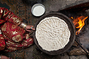 "In the kicthen making ""nan"", the flat bread. Daily life at the Khan (chief) summer camp of Kara Jylga...Trekking through the high altitude plateau of the Little Pamir mountains (average 4200 meters) , where the Afghan Kyrgyz community live all year, on the borders of China, Tajikistan and Pakistan."