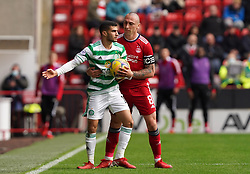 Celtic's Liel Abada (left) and Aberdeen's Scott Brown during the cinch Premiership match at Pittodrie Stadium, Aberdeen. Picture date: Sunday October 3, 2021.