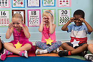 Middletown, New York - Children in the YMCA of Middletown  preschool and pre-kindergarten programs visit their classrooms with their parents on the day before the first day of school on Sept. 3, 2017.