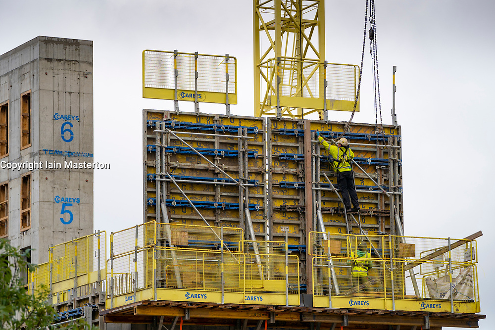 Edinburgh, Scotland, UK. 5 October, 2020. Construction worker fitting formwork for a concrete pour at Moda's new Springside urban village property development at Fountainbridge in Edinburgh.  Iain Masterton/Alamy Live News
