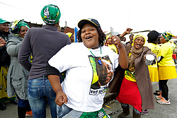 Wednesday 8th May 2019.<br /> Monwabisi Park, Harare,<br /> Khayelitsha, Cape Town, <br /> Western Cape, <br /> South Africa.<br /> <br /> SOUTH AFRICAN GENERAL ELECTIONS 2019!<br /> <br /> SOUTH AFRICAN PROVINCIAL AND NATIONAL ELECTIONS 2019! <br /> <br /> An ANC supporter wears ANC colours and a blue whistle as she and other ANC supporters dance and sing political songs together outside the voting station at Monwabisi Park, Harare in Khayelitsha near Cape Town, Western Cape, South Africa.<br /> <br /> Registered South African Voters head to the various IEC (Independent Electoral Commission) Voting Stations where they are registered to vote as they cast their votes and take part in voting and other activities on Voting Day 8th May 2019 during the South African General Elections 2019. Voters from across the nation stood in queue's along with many others to vote in the Provincial and National Elections being held in South Africa on Wednesday 8th May 2019.   <br />  <br /> Copyright © Mark Wessels. All Rights Reserved. No Usage Without Permission.<br /> <br /> PICTURE: MARK WESSELS. 08/05/2019.<br /> +27 (0)61 547 2729.<br /> mark@sevenbang.com<br /> studioseven@mweb.co.za<br /> www.markwesselsphoto.com