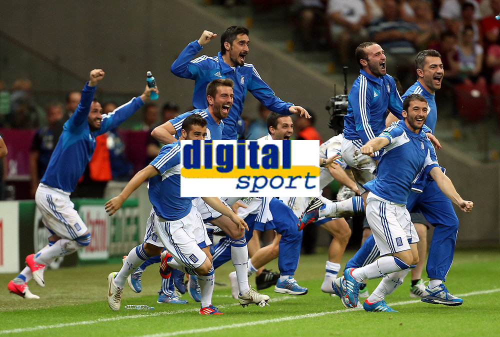 Football - European Championships 2012 - Greece v Russia<br /> <br /> Greece replacements celebrate at full time as they reach the quarter finals at the National Stadium, Warsaw