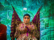 18 JANUARY 2015 - BANGKOK, THAILAND: A performer with the Sai Yong Hong Opera Troupe back stage during performance at the Chaomae Thapthim Shrine, a Chinese shrine in a working class neighborhood of Bangkok near the Chulalongkorn University campus. The troupe's nine night performance at the shrine is an annual tradition and is the start of the Lunar New Year celebrations in the neighborhood. The performance is the shrine's way of thanking the Gods for making the year that is ending a successful one. Lunar New Year, also called Chinese New Year, is officially February 19 this year. Teochew opera is a form of Chinese opera that is popular in Thailand and Malaysia.             PHOTO BY JACK KURTZ