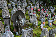 """In Japan, Buddhist statues of Jizo (or respectfully Ojizo-sama) can sometimes be seen wearing tiny children's clothing or red bibs, or with toys, placed by grieving parents to protect their lost ones. Ojizo-sama is one of the most loved of Japanese divinities. His features are commonly made more baby-like to resemble the children he protects. His statues are a common sight along roadsides and graveyards. Traditionally, he is seen as the guardian of children, and in particular, children who died before their parents. Jizo has been worshipped as the guardian of the souls of mizuko, the souls of stillborn, miscarried or aborted fetuses (""""water children""""). Jizo is a Japanese version of Ksitigarbha (Sanskrit for """"Earth Treasury"""", """"Earth Store"""", """"Earth Matrix"""" or """"Earth Womb""""), a bodhisattva revered in East Asian Buddhism. Ksitigarbha is usually depicted as a Buddhist monk with a halo around his shaved head. He carriesa staff to force open the gates of hell and a wish-fulfilling jewel to light up the darkness. Kiyomizu-dera (""""Pure Water Temple"""") is an independent Buddhist temple in eastern Kyoto, Japan. Otowa-san Kiyomizu-dera temple is part of the Historic Monuments of Ancient Kyoto (Kyoto, Uji and Otsu Cities) UNESCO World Heritage site. Kiyomizu-dera was founded on the site of the Otowa Waterfall in the early Heian period, in 780 by Sakanoue no Tamuramaro. Ordered by Tokugawa Iemitsu, its present buildings were built entirely without nails in 1633."""