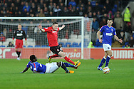 Joe Mason of Cardiff city © is tackled by Guirane N'Daw of Ipswich. NPower championship, Cardiff city v Ipswich Town at the Cardiff city Stadium in Cardiff, South Wales on Saturday 12th Jan 2013. pic by Andrew Orchard, Andrew Orchard sports photography,