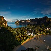 Hat Tham Phra Nang Peninsula houses Rai Lay Beach, Phra Nang Beach, and is world famous for rock climbing on beautiful limestone towers.  Krabi Province, Thailand