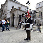 A Royal Horse Guard pose in Whiteall