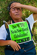 12 SEPTEMBER 2003 - CANCUN, QUINTANA ROO, MEXICO:  A South Korean anti-WTO protester sleeps in a park in Cancun. Tens of thousands of protesters, mostly farmers, came to Cancun for the fifth ministerial of the World Trade Organization (WTO). They were protesting against developed nations pushing to get access to agricultural markets in developing nations. The talks ultimately collapsed after no progress with no agreements reached between the participants.          PHOTO BY JACK KURTZ