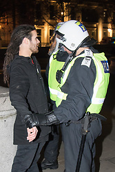 London, November 5th 2016. Anti-capitalists and anarchists participate in the Million Mask March, an annual event that happens on November 5th each year in cities across the world, as part of a protest against the establishment. Many of the protesters wear Guy Fawkes masks, often associated with the internet activism group Anonymous. PICTURED: A protester is detained after placing an empty beer can on an officer's helmet.