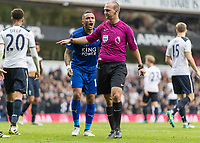Football - 2016 / 2017 Premier League - Tottenham Hotspur vs. Leicester City<br /> <br /> Referee Robert Madley points to the penalty spot whilst Danny Simpson of Leicester City screams his disbelief at White Hart Lane.<br /> <br /> COLORSPORT/DANIEL BEARHAM