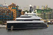 The brand new 74.5m long superyacht, Elandess is seen moored at HMS President on the River Thames on July 05, 2018 after making its maiden voyage to London this week. Elandess was built at the Abeking and Rasmussen shipyard in Germany for owner, Lloyd Dorfman, the founder of Travelex, was launched in May 2018 and has just completed sea trials ahead of its London visit. Elandess has an axe-bow, dark hull and low-slung superstructure. There are a variety of entertaining communal spaces, from the 8 x 2.5-metre superyacht swimming pool located on the massive sun deck to the Nemo Lounge with portholes below the waterline and an observation lounge on the upper deck. Guest accommodation includes six staterooms, including the master suite which is placed forward on the main deck with an observation lounge directly above on the upper deck.