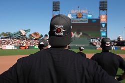 Oct 3, 2021; San Francisco, California, USA;  San Francisco Giants players and coaches sport new caps as they celebrate their 11-4 victory over the San Diego Padres at Oracle Park. The Giants clinched the National League West Division with the win. Mandatory Credit: D. Ross Cameron-USA TODAY Sports