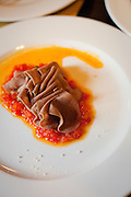 Italian cuisine at its finest: Beef tongue (lingua) served over Fra Diavolo sauce at a restaurant in La Morra (Piedmont), Italy.