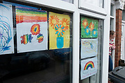 Local response to Coronavirus is felt on a street by street level as children put up rainbow paintings in the windows of their homes on 29th March 2020 in Birmingham, England, United Kingdom. Rainbows, mostly drawn by children, have been appearing in windows right across the UK as people are locked in their homes during the coronavirus outbreak, and want to give out a positive message, in particular to NHS staff and other key workers. Coronavirus or Covid-19 is a new respiratory illness that has not previously been seen in humans. While much or Europe has been placed into lockdown, the UK government has announced more stringent rules as part of their long term strategy, and in particular social distancing.