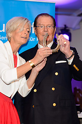 Ann Kathrin Linsenhoff  with Actor Sir Roger Moore, UNICEF ambassador during day one of the 2013 CHIO Aachen tournament on June 25, 2013 in Aachen, Germany. Photo by Schneider-Press / i-Images. UK & USA ONLY