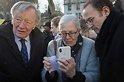 Veteran actor and political activist, Vanessa Redgrave CBE, shows phone footage to Alf Dubbs (left) at a protest for the child refugee charity, Safe Passage, in Parliament Square Westminster, on 20th January 2020, in London, England. Alfred Dubs, Baron Dubs is a British Labour politician and former Member of Parliament.
