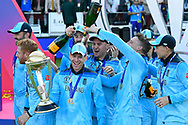 Eoin Morgan of England has champaign tiped over his head by Jos Buttler of England during the trophy presentation celebrations during the ICC Cricket World Cup 2019 Final match between New Zealand and England at Lord's Cricket Ground, St John's Wood, United Kingdom on 14 July 2019.