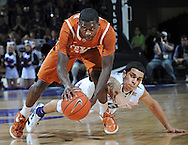 MANHATTAN, KS - JANUARY 18:  Guard Myck Kabongo #12 of the Texas Longhorns goes for a loose ball against guard Angel Rodriguez #13 of the Kansas State Wildcats during the first half on January 18, 2012 at Bramlage Coliseum in Manhattan, Kansas.  (Photo by Peter G. Aiken/Getty Images) *** Local Caption *** Myck Kabongo;Angel Rodriguez