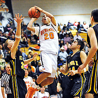 011112  Adron Gardner<br /> <br /> Gallup Bengal Darren Spencer (20) gets a good look at the basket for a field goal in the Gallup Boys Tournament championship against the St. Pius X Sartans at Gallup High School Saturday.
