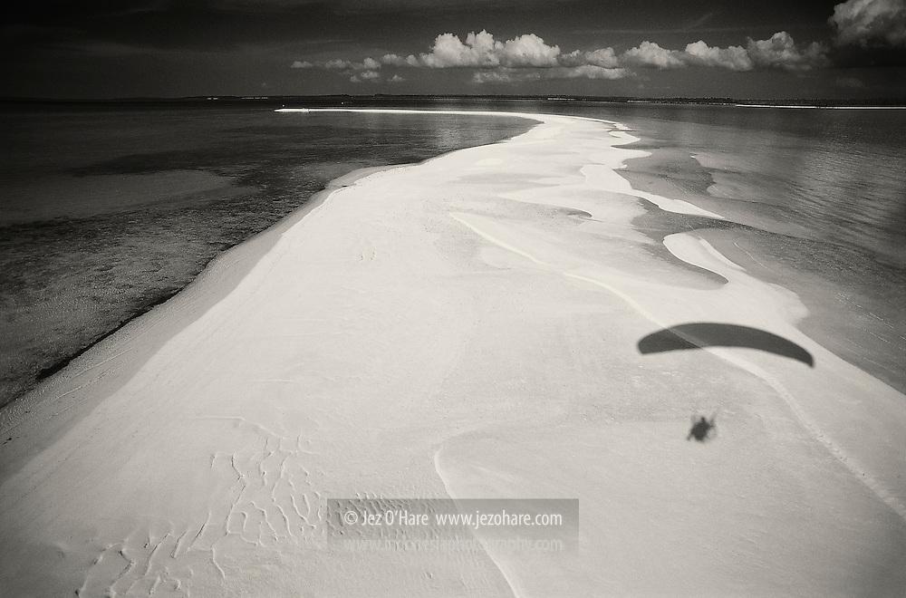 Shadow of motorized paraglider, Waha Island, Kei Archipelago, South East Maluku, Indonesia.