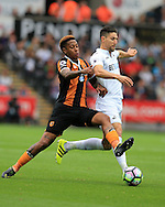 Federico Fernandez of Swansea city ® is tackled by Abel Hernandez of Hull city. Premier league match, Swansea city v Hull city at the Liberty Stadium in Swansea, South Wales on Saturday 20th August 2016.<br /> pic by Andrew Orchard, Andrew Orchard sports photography.