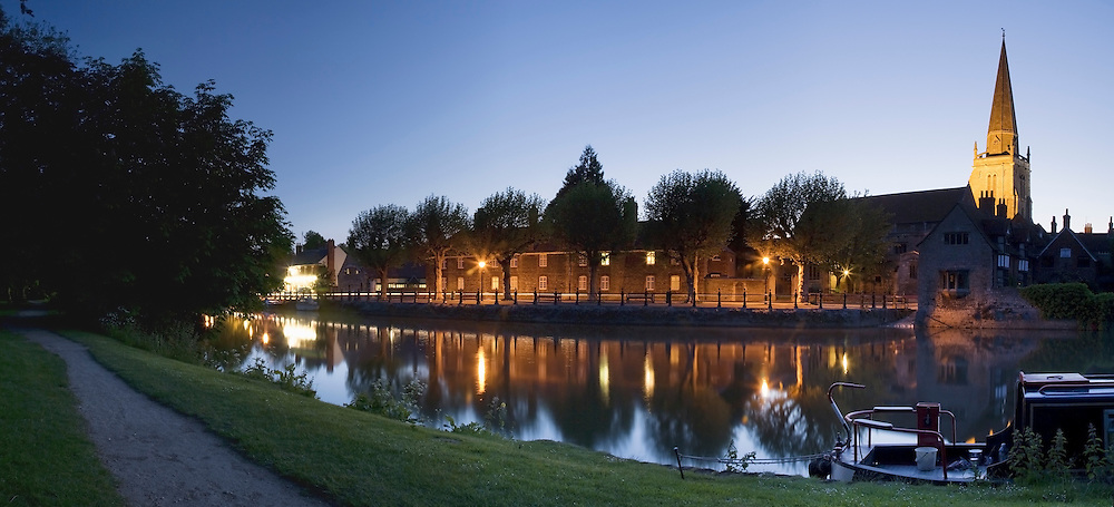 Reflection of St Helen's church spire and Saint Helen's Wharf on the River Thames at Dusk in Abingdon, Oxfordshire, Uk