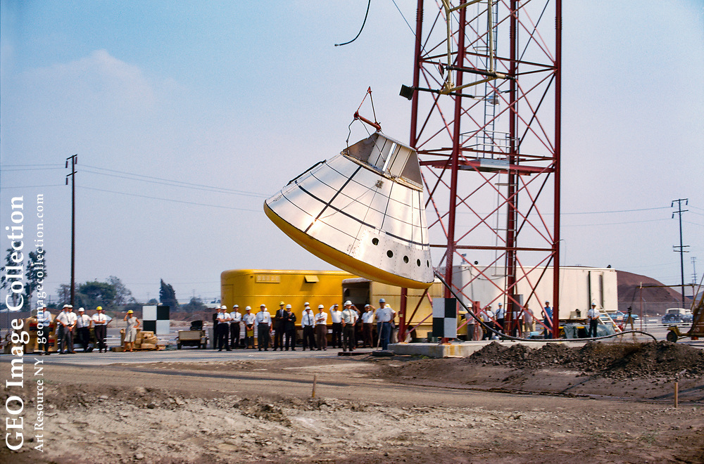 An Apollo command module is dropped to the ground from a tower during tests.