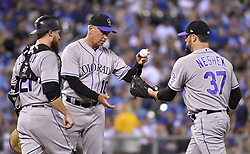 August 22, 2017 - Kansas City, MO, USA - Colorado Rockies manager Bud Black gives the ball to relief pitcher Pat Neshek in the seventh inning against the Kansas City Royals at Kauffman Stadium in Kansas City, Mo., on Tuesday, Aug. 22. 2017. (Credit Image: © John Sleezer/TNS via ZUMA Wire)