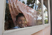 A boy peaks out of a window at School SDN 8 Nan Sabaris (Padang Pariaman district, West Sumatra, Indonesia).
