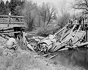 540423-1. Milwaukie bridge collapse over Johnson Creek. Cement truck. April 23, 1954. Riverway Lane bridge across Johnson Creek where it meets the Willamette river. The bridge was not replaced and now this area is Milwuakie Riverfront Park.