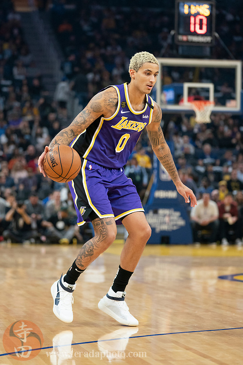 February 27, 2020; San Francisco, California, USA; Los Angeles Lakers forward Kyle Kuzma (0) dribbles the basketball during the second quarter against the Golden State Warriors at Chase Center.