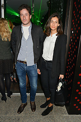 BLAISE PATRICK and PIA STANCHINA at a reception to celebrate Dom Perignon and Iris van Herpen's collaboration 'Metamorphosis' held at the Hus Gallery, 10 Hanover Street, London on 27th October 2014.