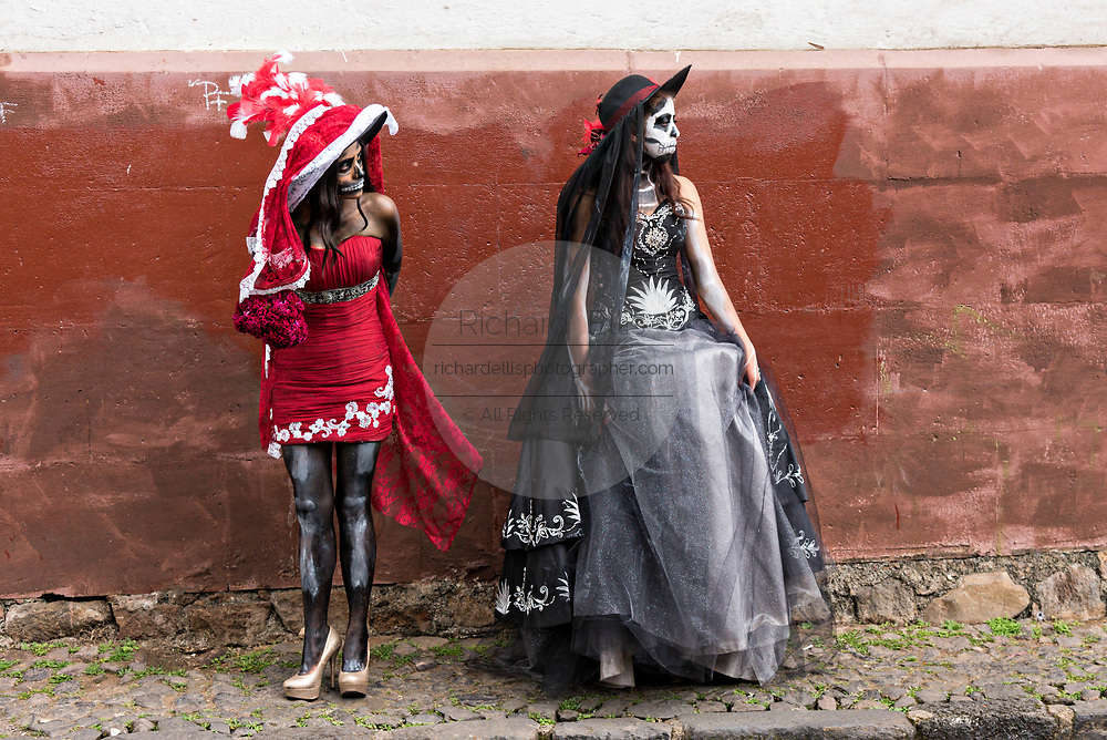 Young Mexican women dressed in La Calavera Catrina costumes during the Day of the Dead or Día de Muertos festival October 31, 2017 in Patzcuaro, Michoacan, Mexico. The festival has been celebrated since the Aztec empire celebrates ancestors and deceased loved ones.