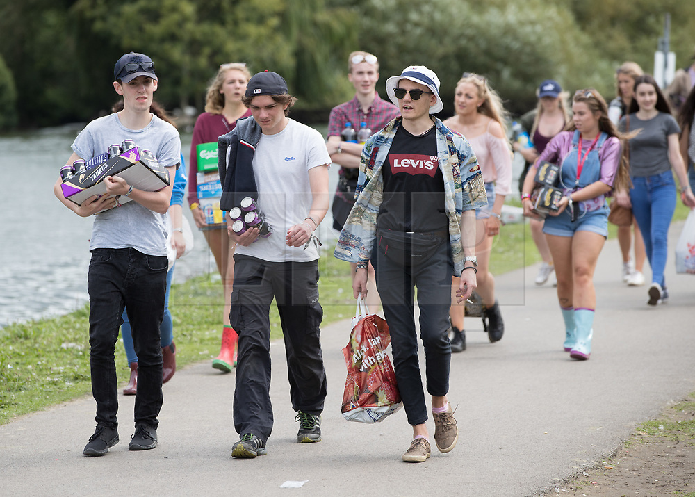 © Licensed to London News Pictures. 24/08/2017. Reading, UK. Music fans make their to Reading Festival . The weather is expected to stay fine for the start of the three day music festival. Photo credit: Peter Macdiarmid/LNP