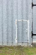 smaller people entrance door in a much larger door