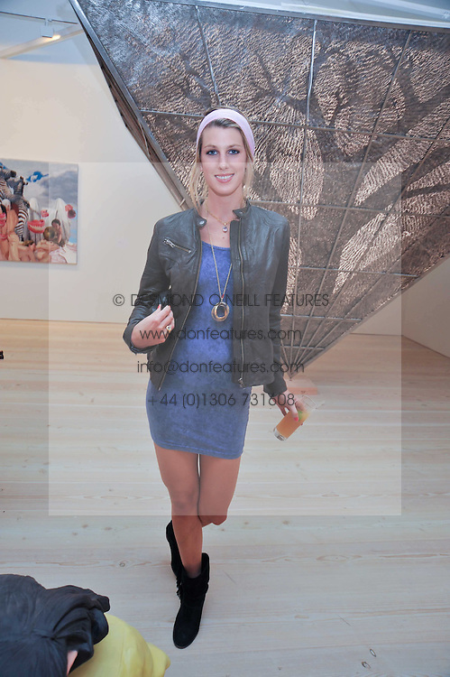 SUSANNA WARREN at an exhibition of photographic portraits by Bryan Adams entitled 'Hear The World' at The Saatchi Gallery, King's Road, London on 21st July 2009.