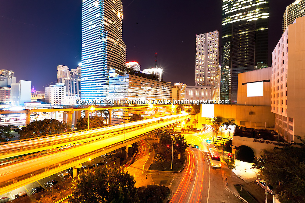 Night view of Miami's downtown commercial and hotel district, expressway ramps to US Route 95 and Metromover elevated rail tracks. WATERMARKS WILL NOT APPEAR ON PRINTS OR LICENSED IMAGES.