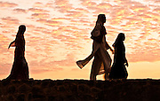 Women taking a walk along the ramparts and enjoying the sunset.<br /> (Photo by Matt Considine - Images of Asia Collection)