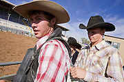 02 NOVEMBER, 2008 -- PHOENIX, AZ: Competitors check each others gear before riding at the Arizona High School Rodeo at the Arizona State Fair in Phoenix. Teams from across the state participate. The Arizona High School Rodeo Association sponsors a full season of high school rodeo that culminate in a championship rodeo in June.  PHOTO BY JACK KURTZ