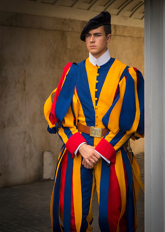 Papal Swiss Guard at one of the entrances to the Vatican, The Guard's uniforms were designed by Michelangelo.