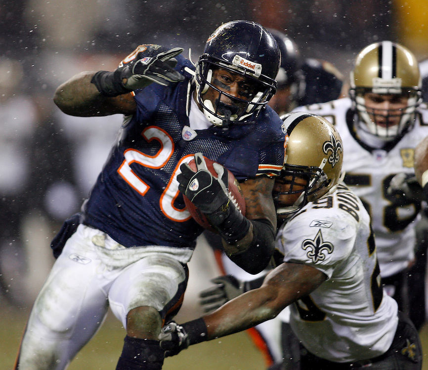 NFC Championship, Chicago Bears vs New Orleans Saints.Chicago's Thomas Jones (20) is tackled by New Orleans' Adrian Peterson (29).