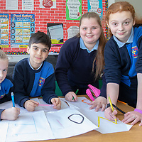 Leah Tuohy, Leon Custy-Sousa, Annabel McDonagh and Ava Wilkie from Scoil Chríost Rí working on their posters for the Jessies Project