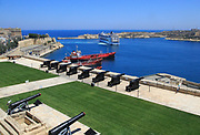 Merchant shipping and cruise ship arriving in Grand Harbour, Valletta, Malta from gun Saluting Battery platform