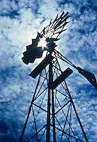 Altocumulus mackerel clouds over a windmill on the Colorado plains.