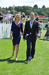 MARTIN LEWIS and his wife LARA LEWINGTON at the 27th annual Cartier International Polo Day featuring the 100th Coronation Cup between England and Brazil held at Guards Polo Club, Windsor Great Park, Berkshire on 24th July 2011.