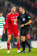 Dominic Ball (#21) of Aberdeen protests as referee Andrew Dallas awards a penalty kick to Celtic during the Betfred Cup Final between Celtic and Aberdeen at Celtic Park, Glasgow, Scotland on 2 December 2018.