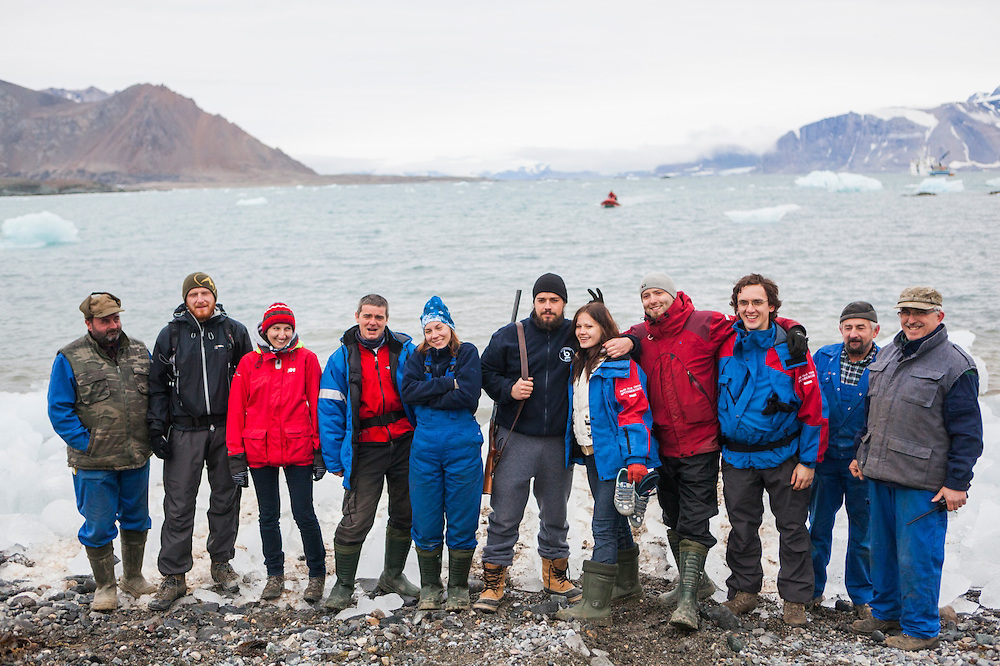 Departing members of the summer field season take a group photo on the beach outside the Polish Polar Station in Hornsund, Svalbard.