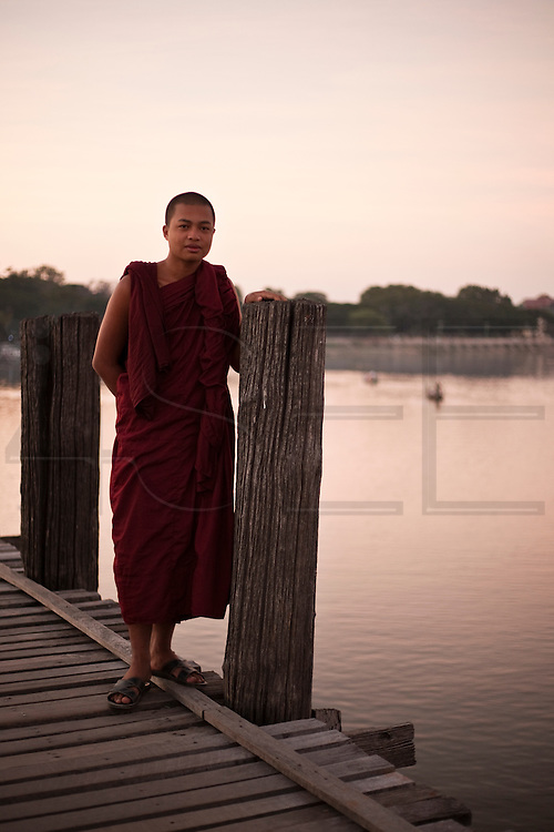 Monke in U Bein Bridge, Amarapura, Burma.<br /> Note: These images are not distributed or sold in Portugal