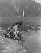 Nootka indian taking ceremonial bath, before whale hunt, c1910. Photograph by Edward Curtis (1868-1952).