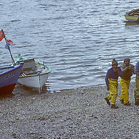 CHILE, Puerto Montt.  Fishermen head for seafood market after a day in the Lakes District fjords.